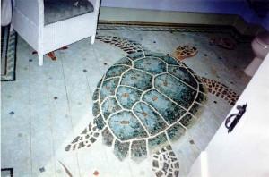 sea turtle painted on a wood floor